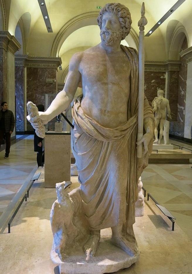 Estátua de Zeus, com sua longa barba e seus símbolos